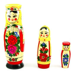 This cute 3 piece nesting doll is from the village of Semyonov, Each of the pieces are brightly painted and cheerfully drawn. The tallest girl is 8 inches tall. The girl doll opens to a girl, then a smaller girl.