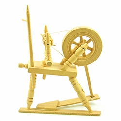 Miniature wooden spinning wheel.  Wheel and spindle turn.  Hand made in Poland.