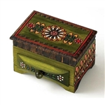 This box features a lidded compartment and a functioning drawer. Gorgeous floral motif carvings decorate the box, and the edges are etched and stained a deep brown. The piece is finished with green stain that gives the box an earthy and unique feel.
