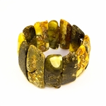 Multi-colored amber cuff bracelet.  Made in Lithuania this gorgeous bracelet features raw semi-polish amber which highlights the natural beauty of the stones.