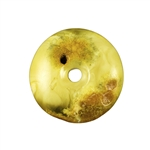 Very impressive polished doughnut shaped honey amber stone for pendant use. Weighs 7g. This amber stone is mainly polished but also has natural rough spots to highlight its natural origins. This stone also has two holes. A small one that occurred naturall
