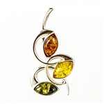 Baltic Amber in shades of Green, yellow, and honey encased sterling silver.