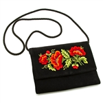 "Hand embroidered clutch purse made from felt and velvet. Fully lined. Extra long strap (extends to 25""). Snap closure. Made in Lowicz, Poland. Flower colors and design vary slightly from purse to purse."