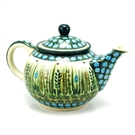 "Beautiful teapot with an 10oz. capacity.Designed By Krystyna Dacyszyn The artist has been connected with the Artistic Handicraft Cooperative ""Artistic Ceramics and Pottery"" since 1990. Since 2002 she has been a pattern designer. Signature Series Pattern:"