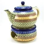 Beautiful teapot with a 1.2 Liter (40oz) capacity (5 cups). and matching warmer set.  Includes a candle holder but no candle.