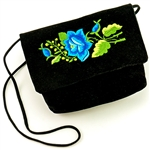 "Hand embroidered clutch purse made from felt and velvet. Fully lined. 17"" long strap.  Snap closure. Made in Lowicz, Poland."