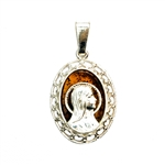 Beautiful oval shaped sterling silver Madonna on a background of natural amber.