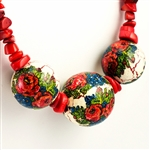 "Beautiful folk necklace made with natural looking coral like beads and decoupaged wooden beads featuring folk flowers.  Adjustable metal clasp.  Maximum length 25"" - 64cm.  Made In Zakopane, Poland."