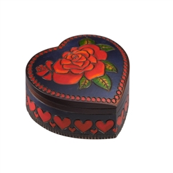 This gorgeous heart shaped box is decorated on the lid with a detailed red rose and green leaves. A red heart pattern adorns the sides of the box. A swiveling lid and a dark purple stain complete the item. Handmade in Poland's Tatra Mountain region.