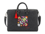 Large handbag made of stiff dark grey felt, which is characterized by high durability. The main decoration is a colorful embroidered Lowicz flower - an original design by Farbotka, inspired by Polish folk culture. Includes an adjustable, detachable strap