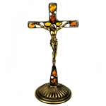 Hand made in Gdansk, the beautiful crucifix is made with natural Baltic amber embedded in an artistic cross. Brass base and body of Christ. Removable base.