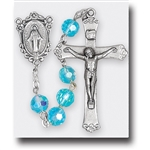 "Polish Art Center - 20.5""  7mm Aqua Tin Cut, Multi Faceted Crystal Round Beads with Aurora Borealis and Deluxe Silver Oxidized Crucifix and Center.  It comes with a Deluxe Velvet Box"