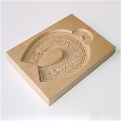 Solid beech wood hand carved mold featuring a traditional good luck (Na Szczescie) horseshoe folk design. This mold comes from the gingerbread museum in Torun, Poland. These types of wooden molds are used to create gingerbread and cookie designs.