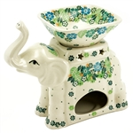 Two part elephant figurine. The base has an opening for a tea light. Use the dish on top to warm your favorite fragrant oil.