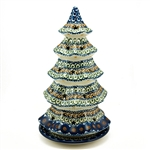 Collectors of Polish stoneware from Poland's premier company, Ceramika Artystyczna, will enjoy this unique item. Each of the stars on the tree is cut out to allow heat out.