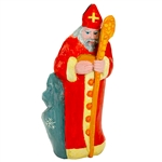 "This St. Nicholas was carved and painted by Polish folk artist Leszek Pliniewicz.  Mr. Pliniewicz's works are quite interesting and in a ""primitive"" style.  Carved from one piece of wood.  The staff has a crack just above St. NIcholas's hand which is why"