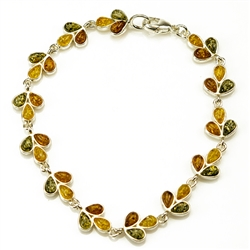"Three colors of amber set in silver shaped to form a trail of leaves in this lovely bracelet 7"" - 18cm long."
