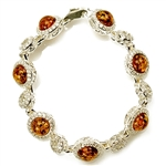 "7 round amber beads each set in a sparkling sterling silver frame. 7"" - 18cm long."