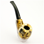 A tobacco pipe clad in amber pieces.  Made In Lithuania.