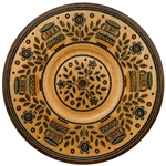 This Polish plate is made from beech wood in the mountain region of southern Poland called Podhale. The plates are cut and shaped on a lathe by hand. The floral designs are burned into the wood then painted after staining