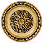This Polish plate is made from beech wood in the mountain region of southern Poland called Podhale. The plates are cut and shaped on a lathe by hand. The designs are burned into the wood then painted after staining and varnishing. All the designs are