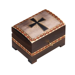 The lid of this chest box features a hand carved cross. The edges of the lid and the sides of the box have additional carved details. A lock and key secure the lid. Handmade in the Tatra Mountain region of Poland.Handmade in Poland's Tatra Mountain region