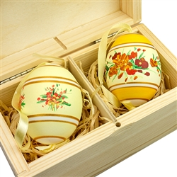 Hand painted duck eggs with floral designs inside a hand painted wooden box. The duck eggs have been blown empty and come with their own hangers. They come nested inside this beautiful box. Magnetized lid. Hand made so no two eggs or boxes are exactly ali