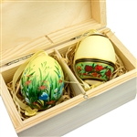 Beautifully hand painted duck eggs inside a hand painted wooden box. The duck eggs have been blown empty and come with their own hangers. They come nested inside this beautiful box. Magnetized lid. Hand made so no two eggs or boxes are exactly alike.