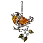 "Our silver bird is studded with cubic zirconia and highlighted with Baltic amber.  Size approx 1.75"" x 1""."