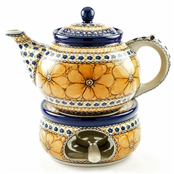 "Beautiful teapot with a 1.2 Liter (40oz) capacity (5 cups). Set includes teapot, warmer and holder for a tea light. Pattern designed by Jacek Chyla. The artist has been connected with the Artistic Handicraft Cooperative ""Artistic Ceramics and Pottery"""