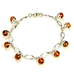 "9 round amber beads each set in a sparkling sterling silver base. 7"" - 18cm long."