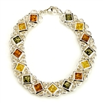 "15 square amber beads each set in a sparkling sterling silver frame. 7.5"" long."