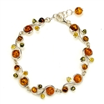 "Three colors of amber set in silver shaped to form a colorful trail in this lovely bracelet 8"" long."