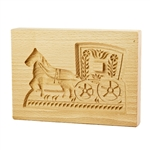 Solid beech wood hand carved mold featuring a traditional horse and carriage folk design. This mold comes from the gingerbread museum in Torun, Poland. These types of wooden molds are used to create gingerbread and cookie designs.