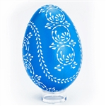 This beautifully designed egg is dyed one color (blue) then white wax is melted and applied using a drop pull technique to form a design which is left on the surface. The egg is then emptied through a hole at the top and bottom. Stand sold separately.