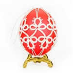 This beautifully designed chicken egg is painted pink and surrounded in a tatted design.