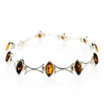 "10 marquis shaped amber beads each set in a sparkling sterling silver frame. 7.5"" long."