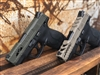 Pictured is the Reaper slide cut in FDE and Silent Agent slide cut in OD green.