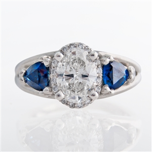 three stone oval halo diamond ring with trillion sapphires