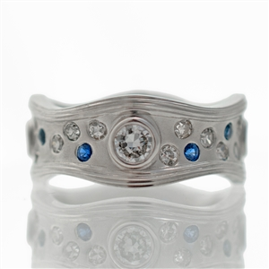 Wavey Sapphire & Diamond Wide Band, 4 bezel set round cut diamonds