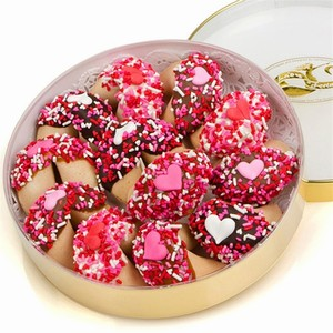 Romantic Wheel of Fortunes - A collection of Lady Fortune dipped fortune cookies decorated with hearts and sprinkles for Valentines Day. Personalize romantic messages hide inside each cookie.