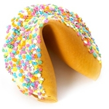 This Easter Gigantic fortune cookie is chocolate covered and decorated with fun flower candies for springing into spring.
