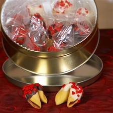 Chocolate covered fortune cookies decorated with Valentine's Day red hearts and filled with romantic messages.