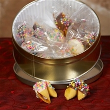 Traditional fortune cookies chocolate covered with pastel candy sprinkles.