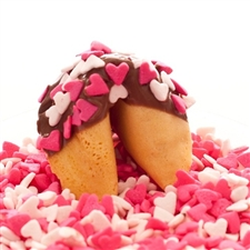 Traditional vanilla fortune cookies covered in chocolate with pink and white heart candy sprinkles! Each fortune cookie comes with your custom sayings inside.