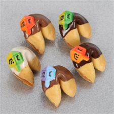 Traditional vanilla fortune cookies covered in chocolate and hand decorated with Hanukkah stars and sprinkles.