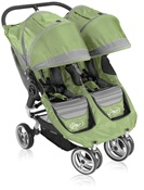 City Mini Double Stroller by Baby Jogger with Quick Easy Fold Technology in Green.