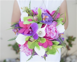 Real Touch Orchid, Plumerias, Peonies and Calla Lilies Mix in Purple, Green and Fuchsia.