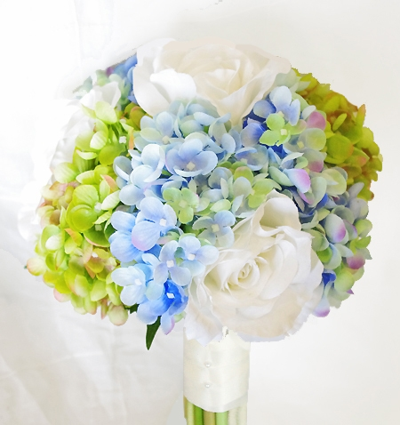 off white roses with green and blue hydrangeas wedding bouquet
