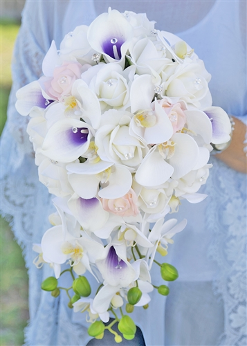 A perfect Blue-Tone Cascade Bouquet made with Natural Touch Off White Roses and Orchids mixed with Blush Roses and Purple Heart Picasso Callas.